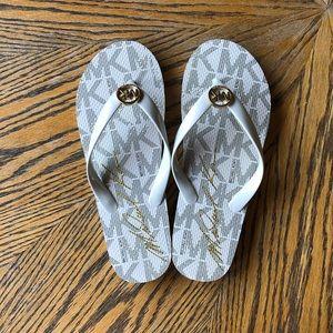 White MK Flip Flops